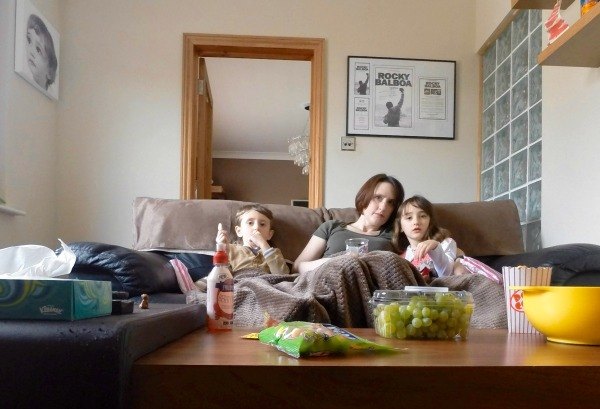 Mother and children on sofa, family film nights